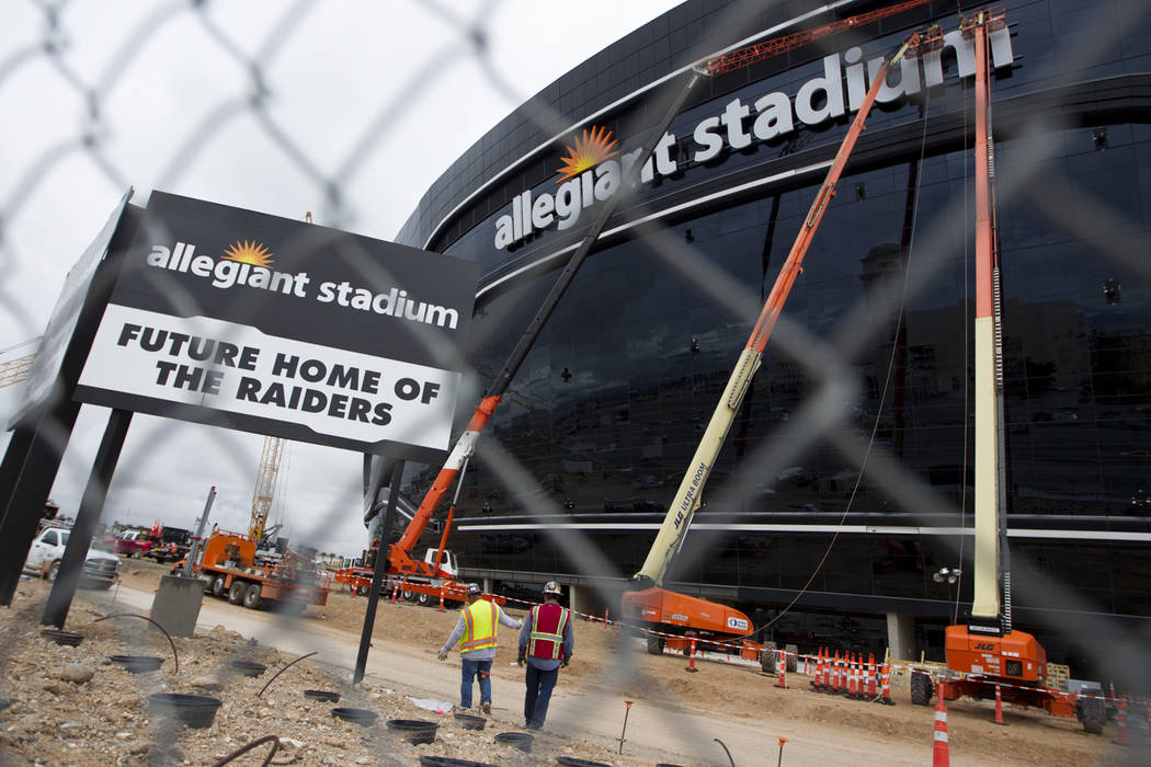 Signage is installed at the Raiders Allegiant Stadium in Las Vegas, Tuesday, March 10, 2020. (E ...