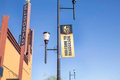 Golden Knights banners adorn light posts on South Water Street in Henderson on Wednesday, Aug. ...