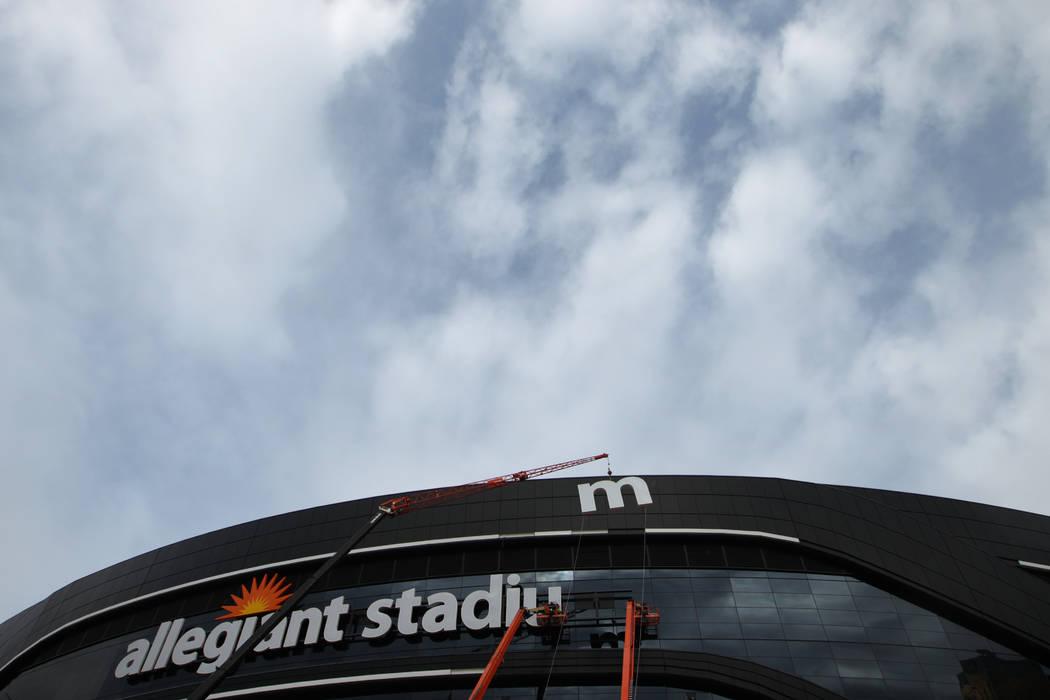 The last letter in the signage for the Raiders Allegiant Stadium logo is installed, in Las Vega ...