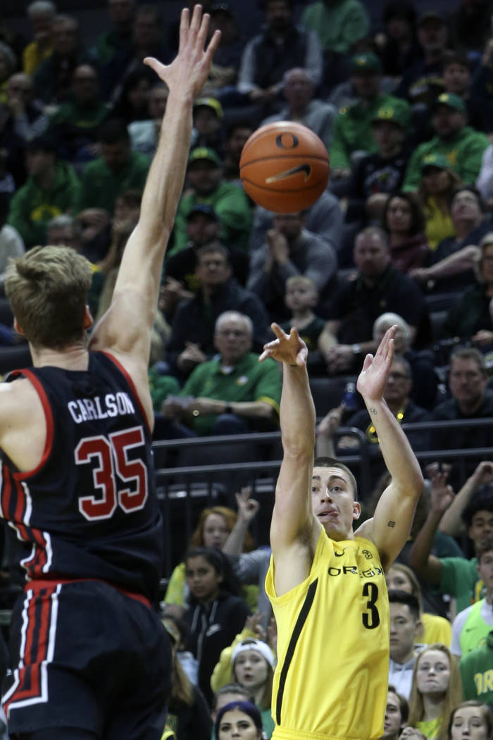 In this Feb. 16, 2020, file photo, Oregon's Payton Pritchard, right, shoots a 3-pointer over Ut ...