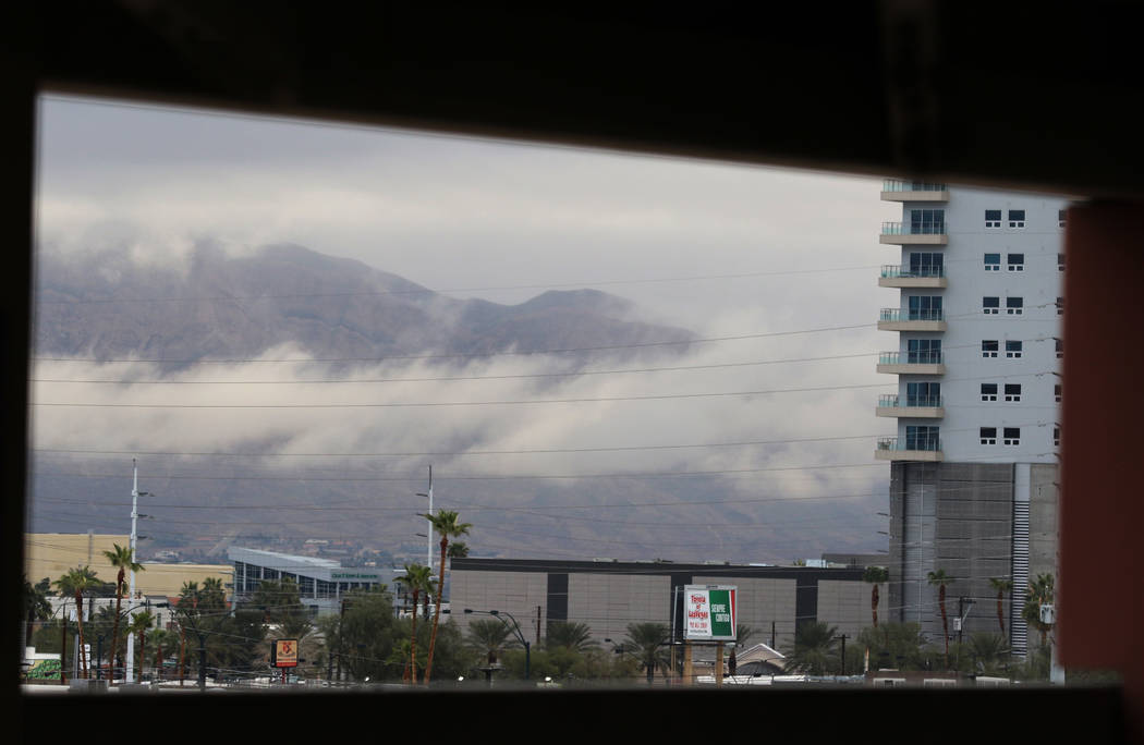 Clouds linger over the Las Vegas valley as seen from the Las Vegas North Premium Outlets' parki ...