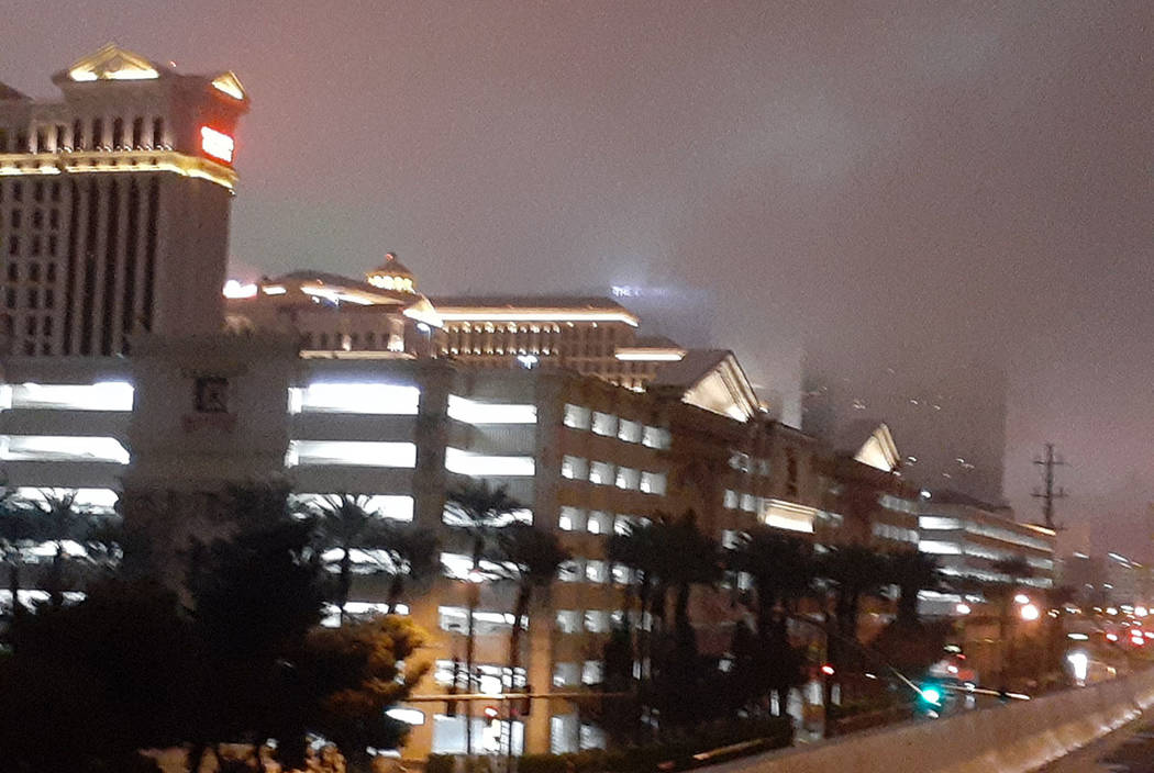 Clouds shroud Caesars Palace and other resorts on the Las Vegas Strip about 2:45 a.m. Wednesday ...
