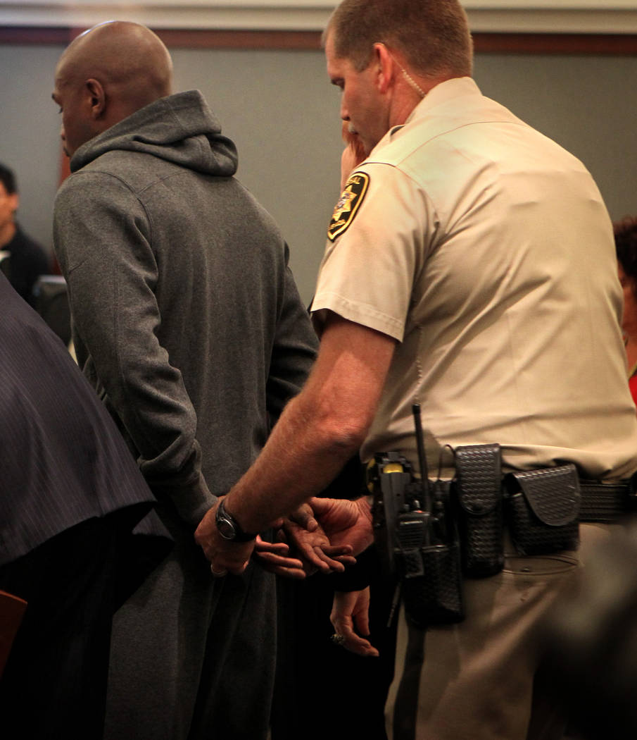 Marshall Ron Johnson prepares to handcuff boxer Floyd Mayweather Jr.'s hands Friday, June 1, 20 ...