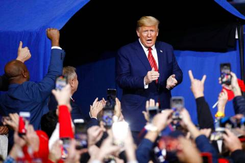 President Donald Trump walks onstage at a campaign rally, Friday, Feb. 28, 2020, in North Charl ...