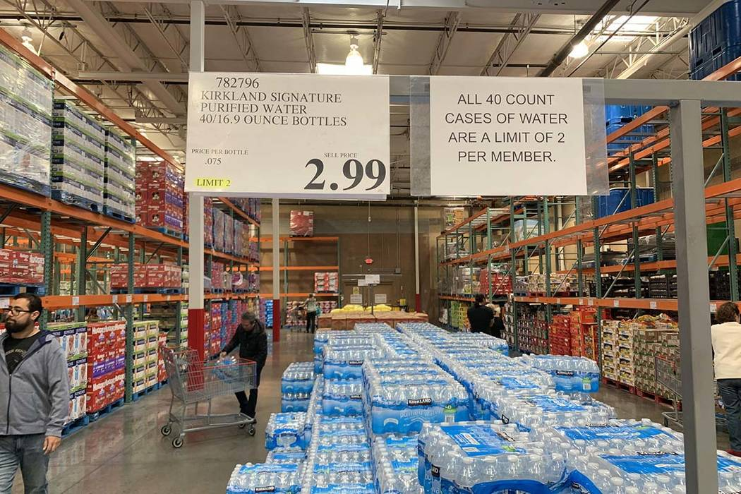 Signs advise of the limits on how many cases of bottled water can be purchased at Costco at 655 ...