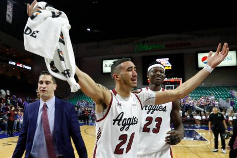 New Mexico State guard Trevelin Queen (20) and forward Mohamed Thiam (23) celebrate the team's ...