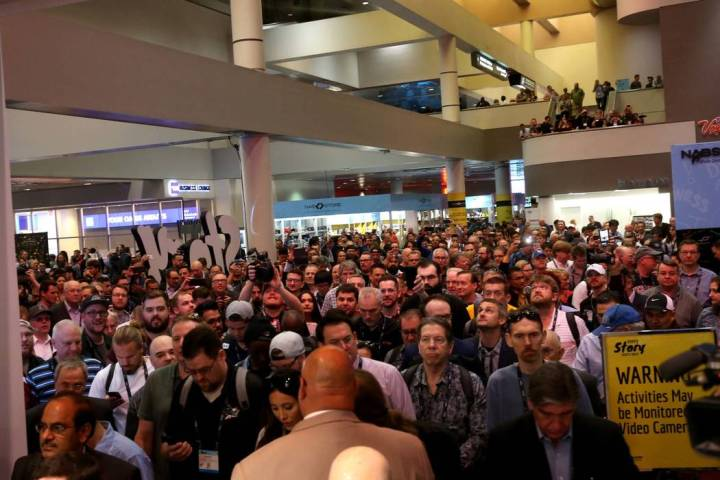 Conventioneers pour onto the show floor on the opening day of the National Association of Broad ...
