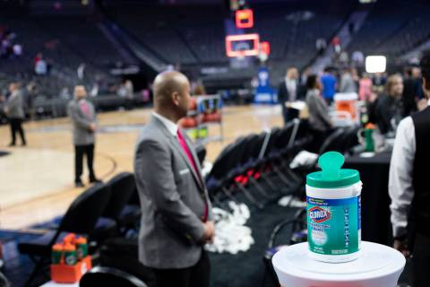 A container of Clorox wipes sits on top of Gatorade coolers during the Pac-12 tournament at T-M ...