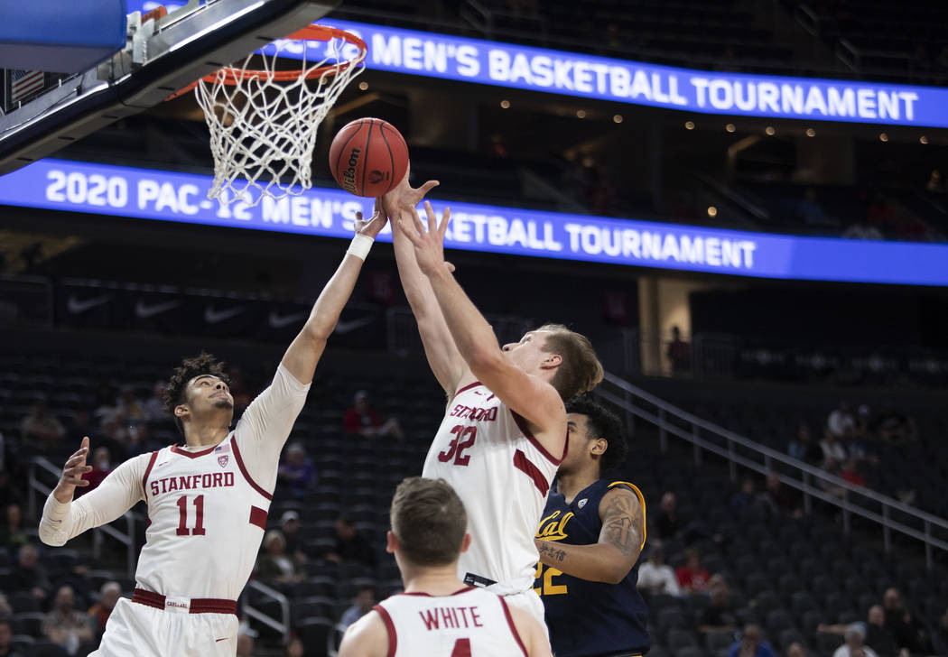 Stanford's forward Jaiden Delaire (11) and forward Lukas Kisunas (32) jump to block a shot by U ...