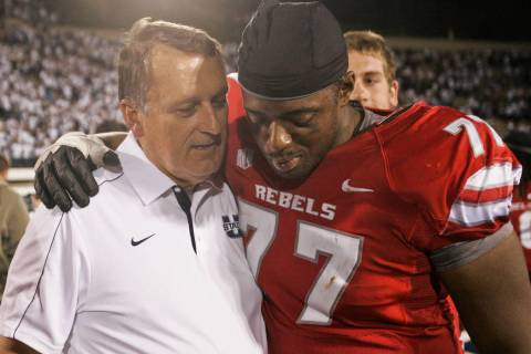 Former UNLV head coach and current Utah State assistant head coach Mike Sanford, left, shares a ...