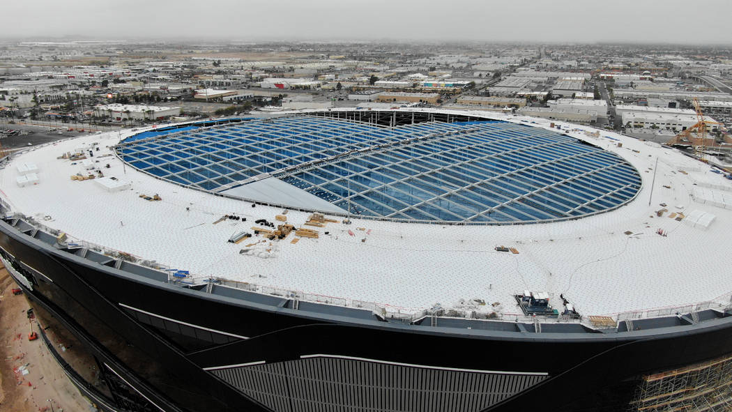 Aerial view of Allegiant Stadium shows the initial installation of the first ETFE panels near t ...