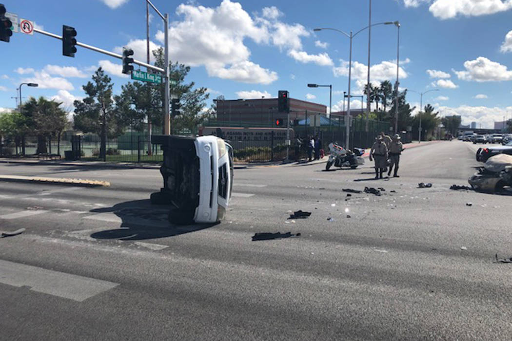 Police investigate a crash Wednesday, March 11, 2020, at the intersection of West Washington Av ...