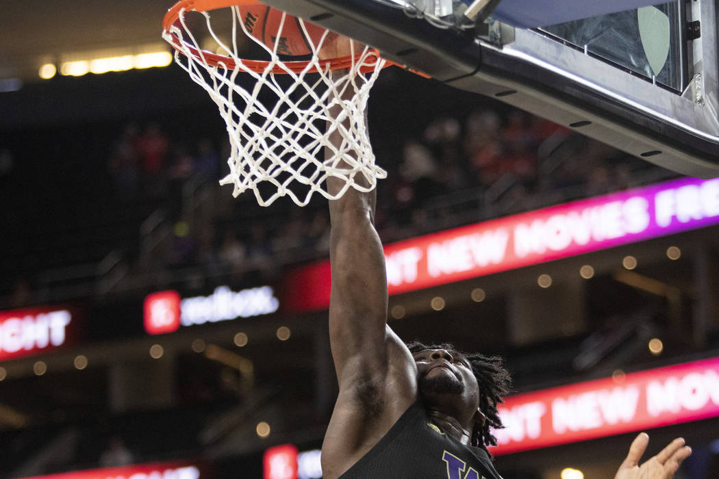 University of Washington's forward Isaiah Stewart (33) shoots a point against Arizona during th ...
