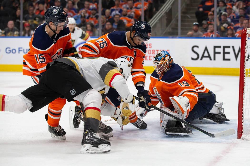 Edmonton Oilers' Darnell Nurse (25) and goaltender Mikko Koskinen (19) keep Vegas Golden Knight ...