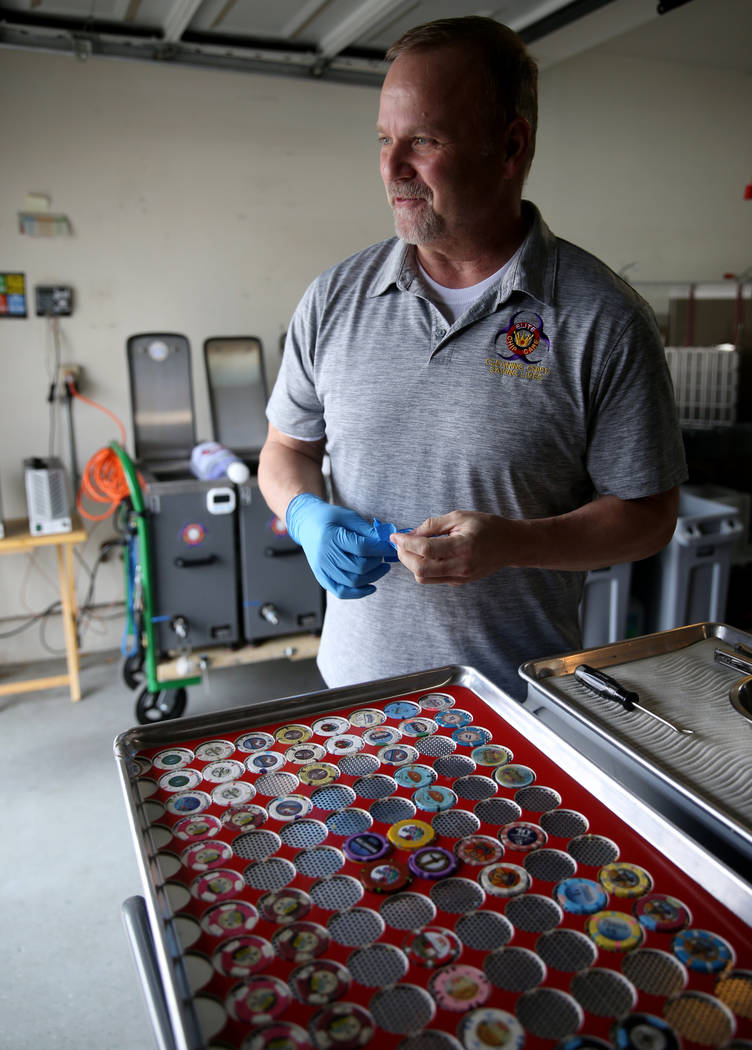 Clay Dubois, owner of Elite Chip Care, a local casino chip cleaning and sanitation company, tal ...
