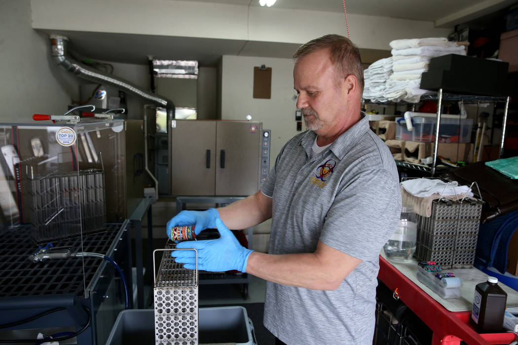 Clay Dubois, owner of Elite Chip Care, a local casino chip cleaning and sanitation company, dem ...