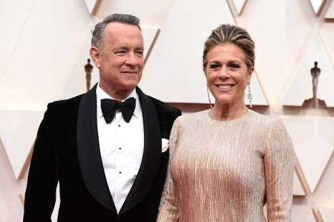 FILE - In this Feb. 9, 2020 file photo, Tom Hanks, left, and Rita Wilson arrive at the Oscars a ...