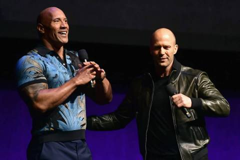 Dwayne Johnson and Jason Statham appear at The Colosseum at Caesars Palace during CinemaCon, th ...