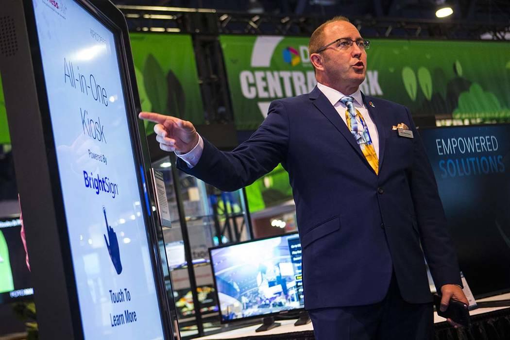 Brian McClimans, vice president of sales at Peerless-AV, shows off an all-in-one digital kiosk ...