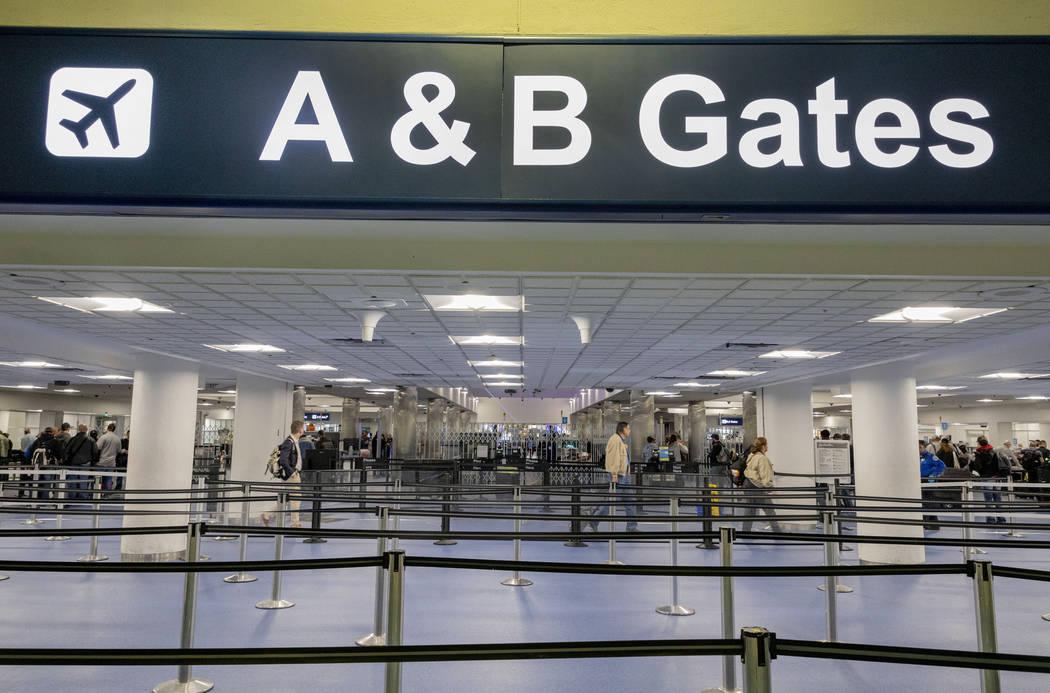 Passengers enter a security queue at McCarran International Airport in Las Vegas on Thursday, M ...