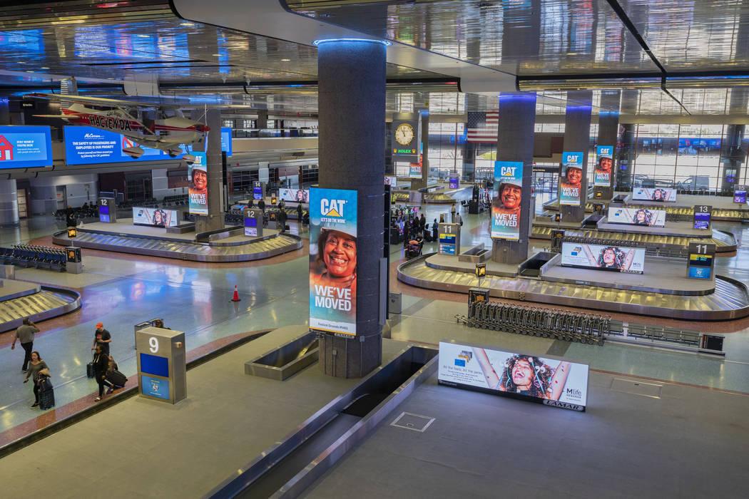 Passengers enter baggage claim at McCarran International Airport in Las Vegas on Thursday, Marc ...