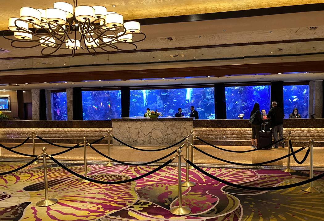 The registration desk at The Mirage on the Strip in Las Vegas Thursday, March 12, 2020. (K.M. C ...
