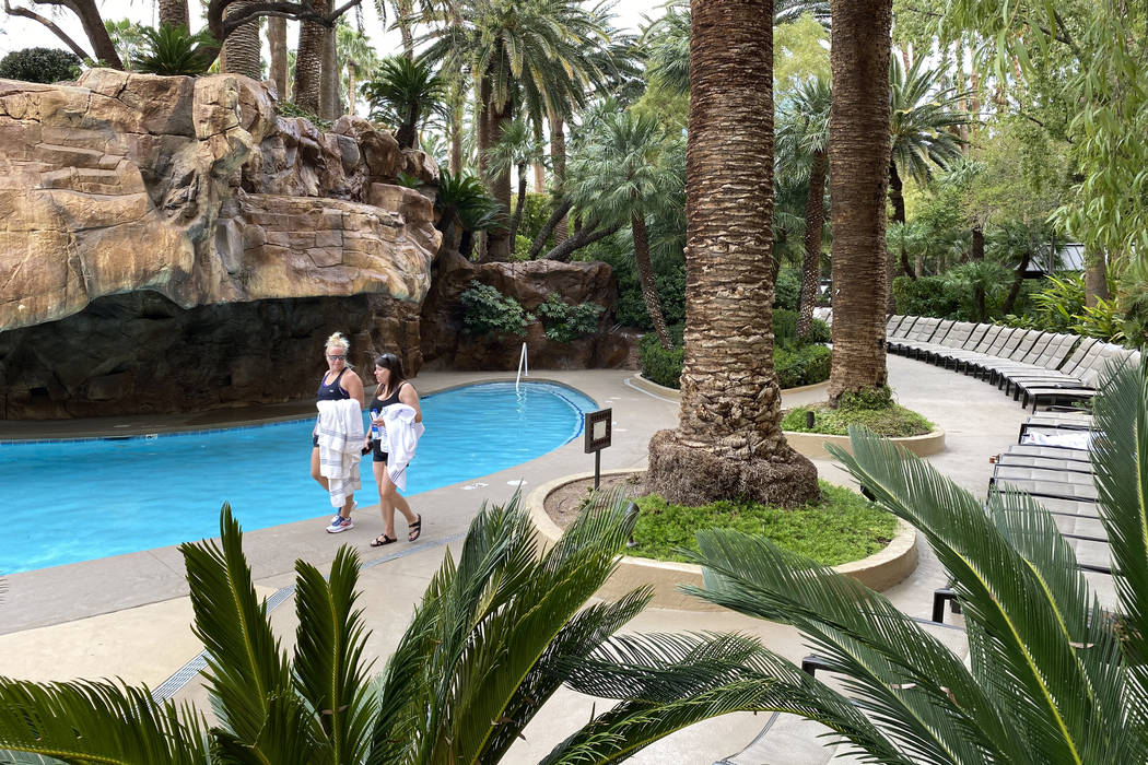 Guests walk along a pool at The Mirage on March 12, 2020, in Las Vegas. (K.M. Cannon/Las Vegas ...
