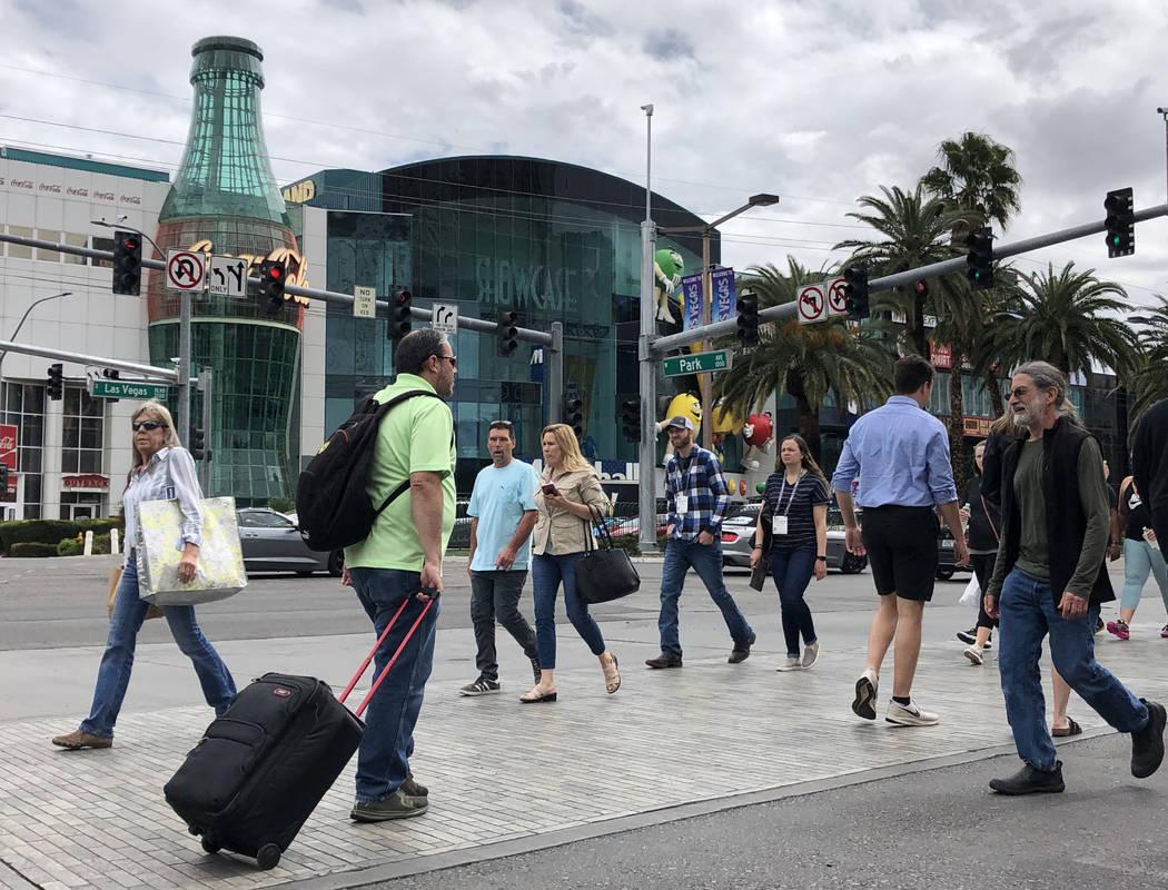 Visitors walk along the Strip on March 12, 2020, in Las Vegas. (Bizuayehu Tesfaye/Las Vegas Rev ...