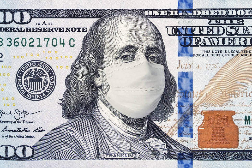 American President with a face mask against CoV infection. 100 dollar banknote. Coronavirus in ...