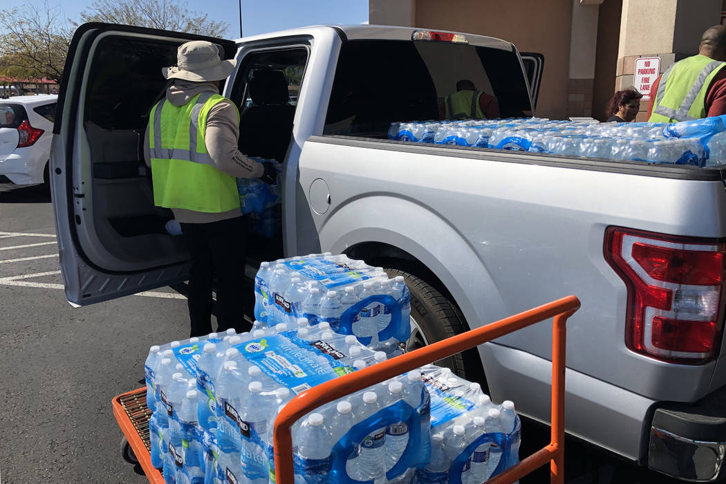 Cases of water are loaded into a truck at Costco Wholesale in Las Vegas on Monday, March 2, 202 ...