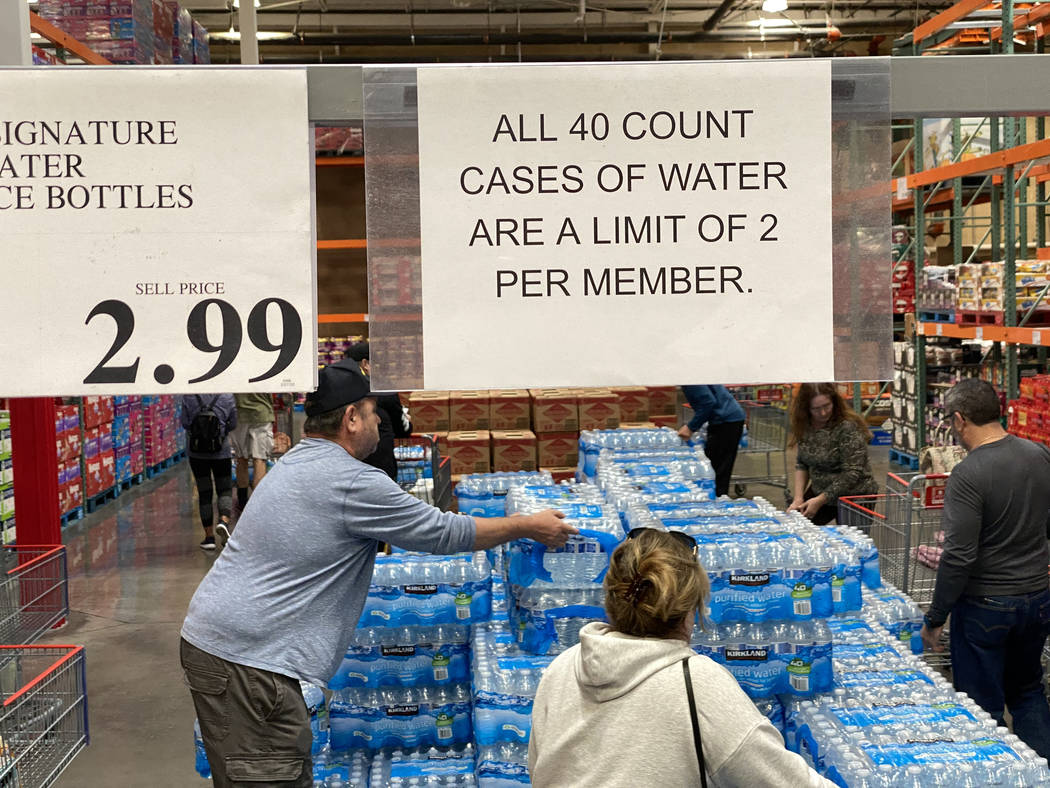 Shoppers at Costco at 6555 N. Decatur Blvd. in Las Vegas buy water Monday, March 9, 2020. (K.M. ...