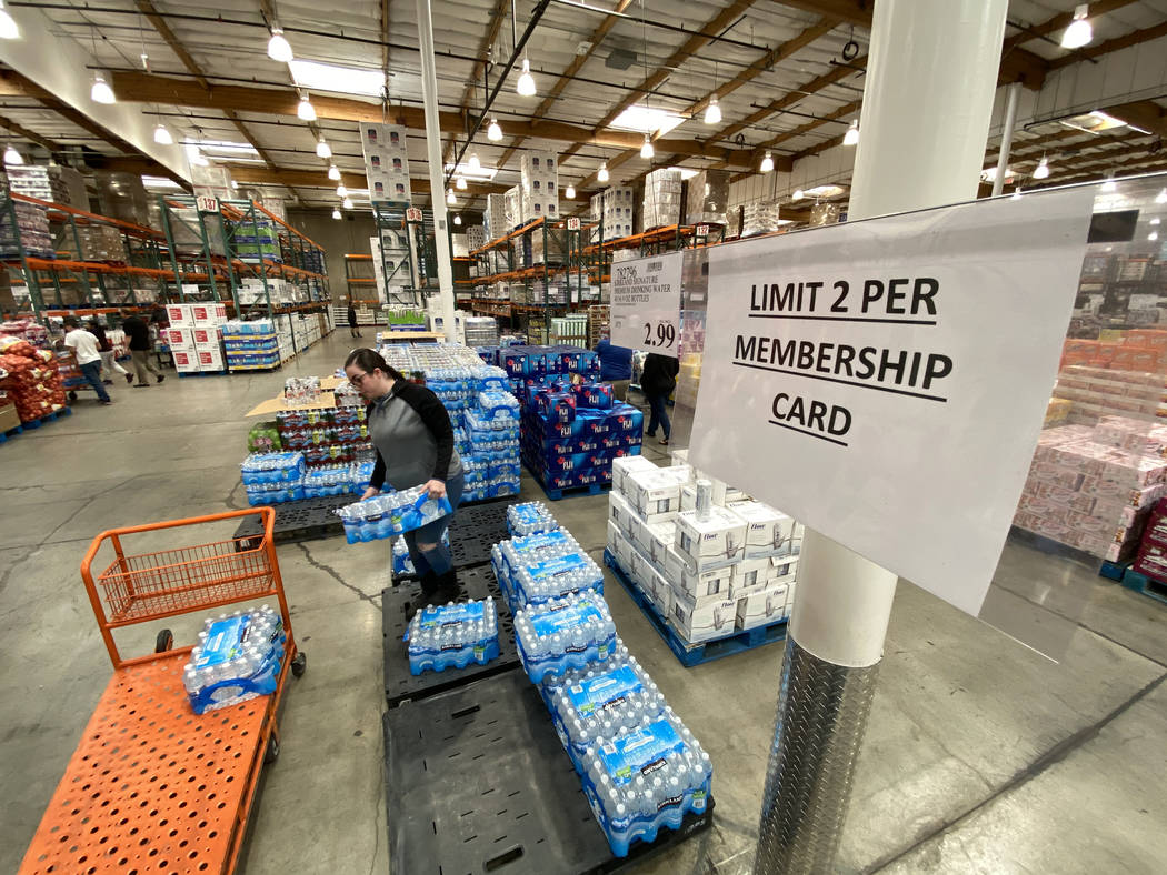 Shoppers, including Gisela Hernandez of Las Vegas, buy water at Costco at 222 S. Martin Luther ...