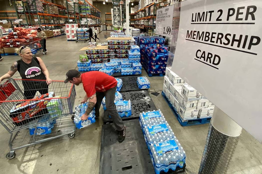 Shoppers, including Kami and Shawn Saunders of North Las Vegas, buy water at Costco at 222 S. M ...