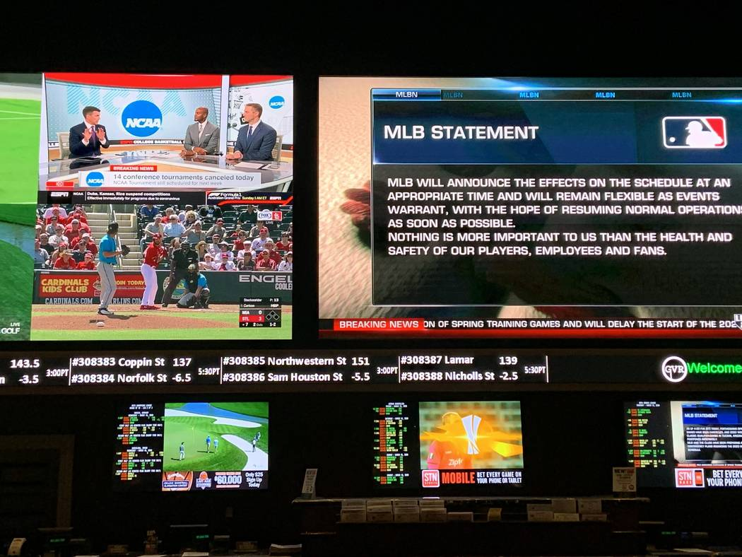 The main TVs at the Green Valley Ranch Resort sportsbook on Thursday show MLB exhibition games ...