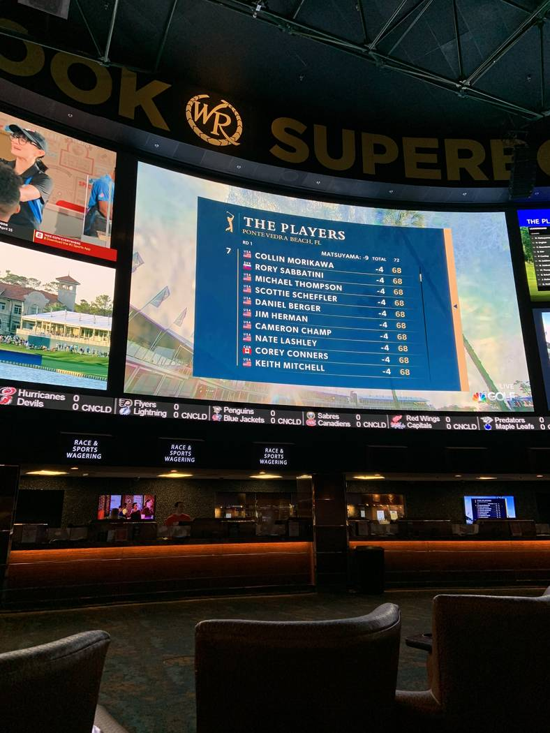 Coverage of The Players Championship is shown on the main screen at the Westgate sportsbook on ...