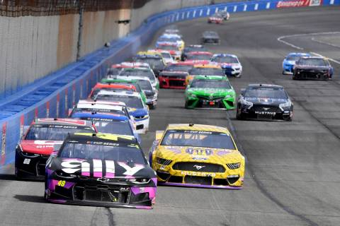 Jimmie Johnson (48) leads the field into Turn 3 during the second stage of a NASCAR Cup Series ...