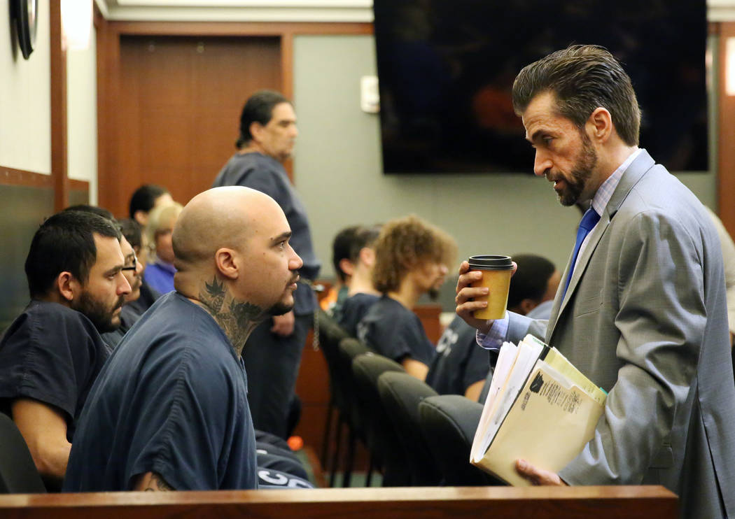 Christopher Weygant, left, talks to his attorney Abel Yanez before his sentencing at the Region ...