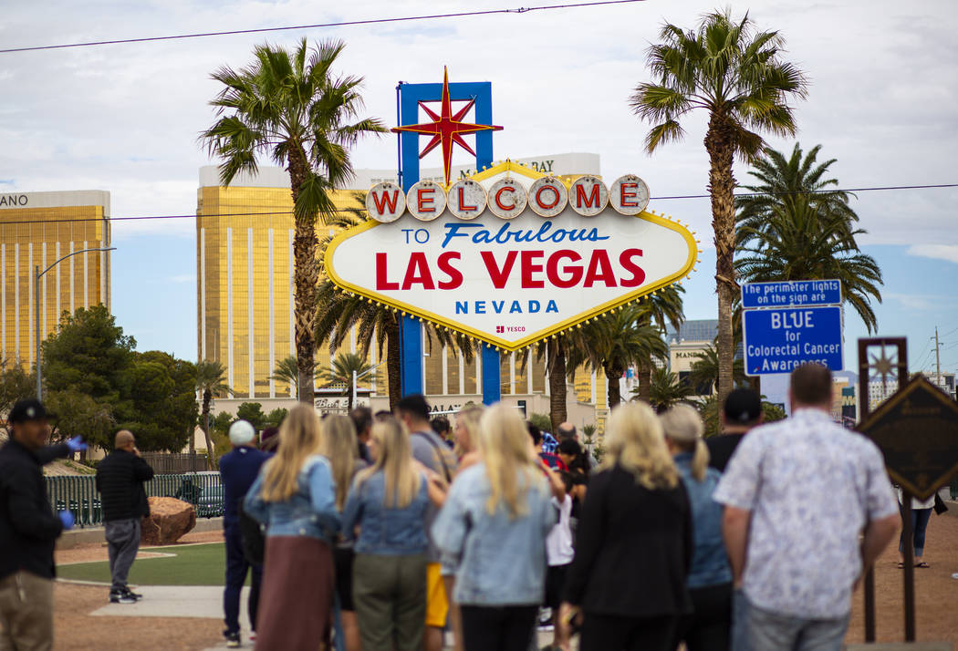 """People line up to take photos by the """"Welcome to Fabulous Las Vegas"""" sign in Las Vega ..."""