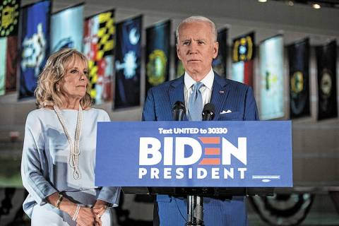 Democratic presidential candidate former Vice President Joe Biden, accompanied by his wife Jill ...