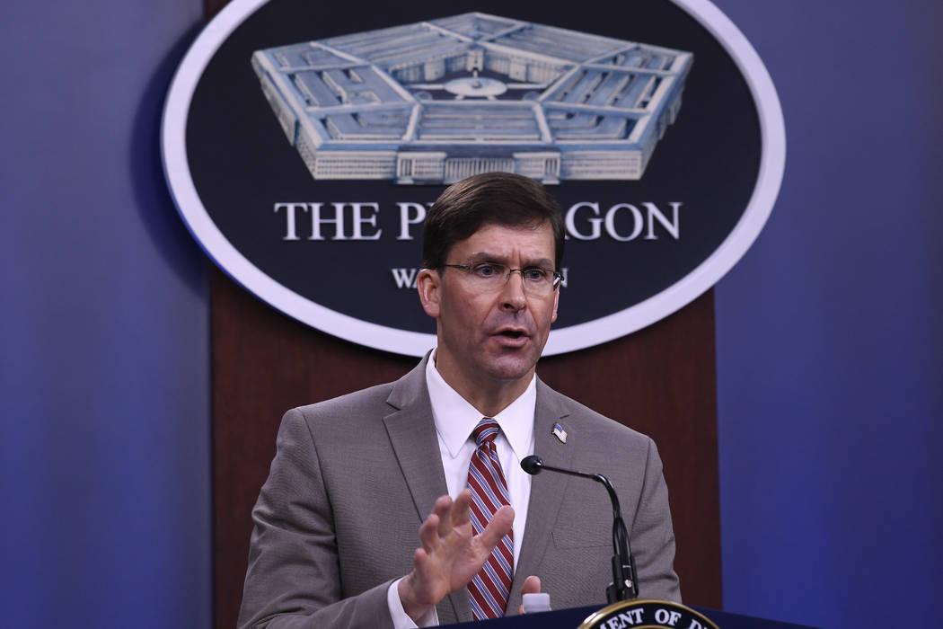 Defense Secretary Mark Esper speaks during a briefing at the Pentagon in Washington, Monday, Ma ...