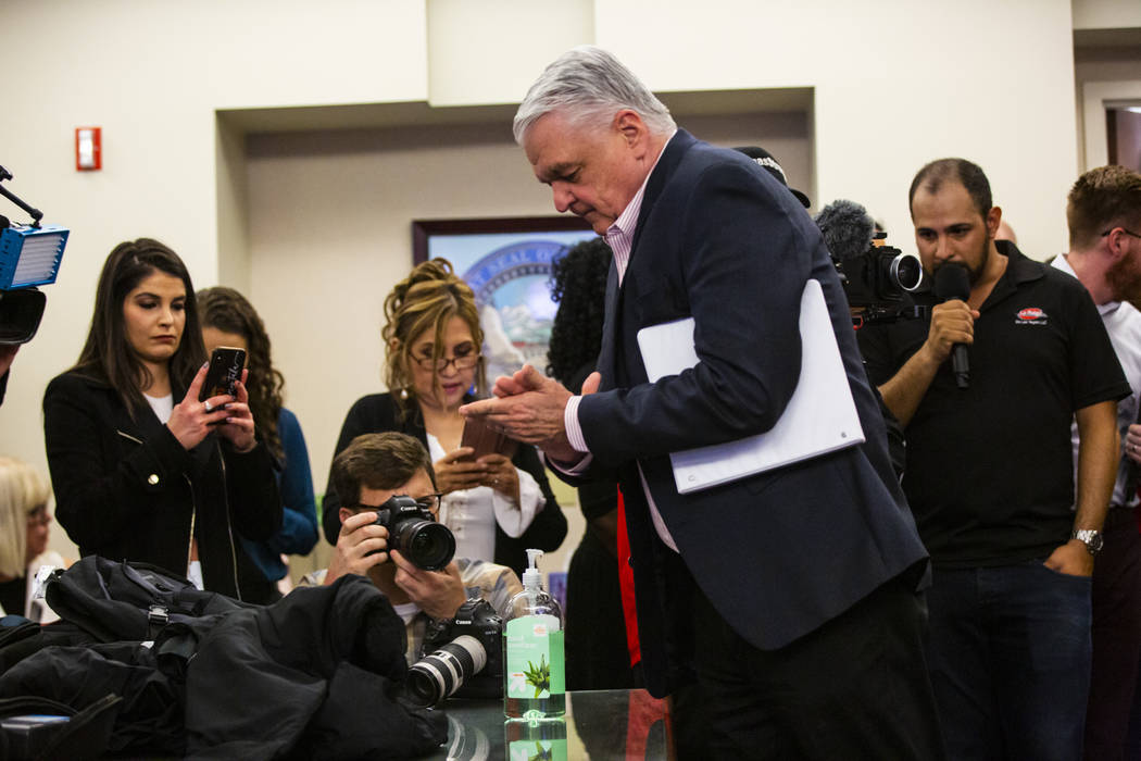 Gov. Steve Sisolak uses hand sanitizer before announcing a state of emergency at the Sawyer Bui ...
