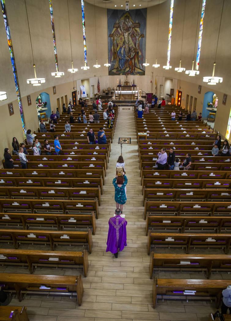 Monsignor Gordon, purple, begins Sunday Mass at St. Anne's Catholic Church where parishioners w ...