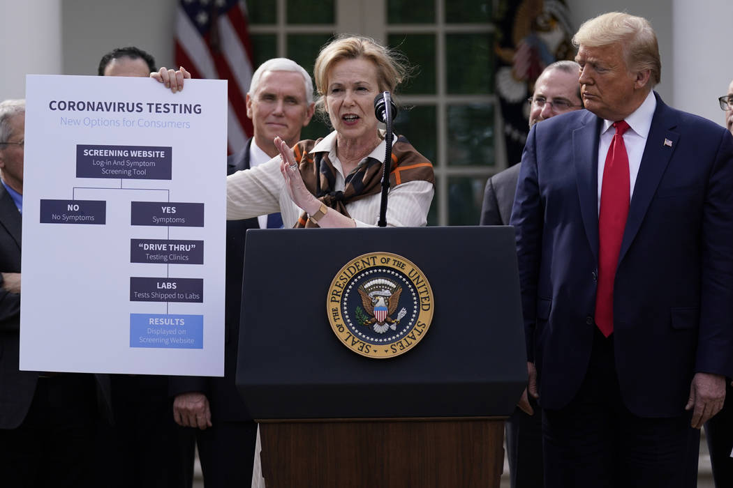 President Donald Trump, right, listens as Dr. Deborah Birx, White House coronavirus response co ...