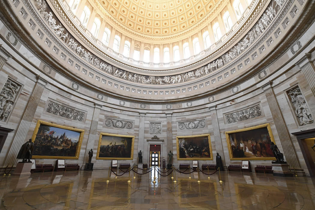 There are no visitors touring the Capitol Rotunda on Capitol Hill in Washington, Friday, March ...