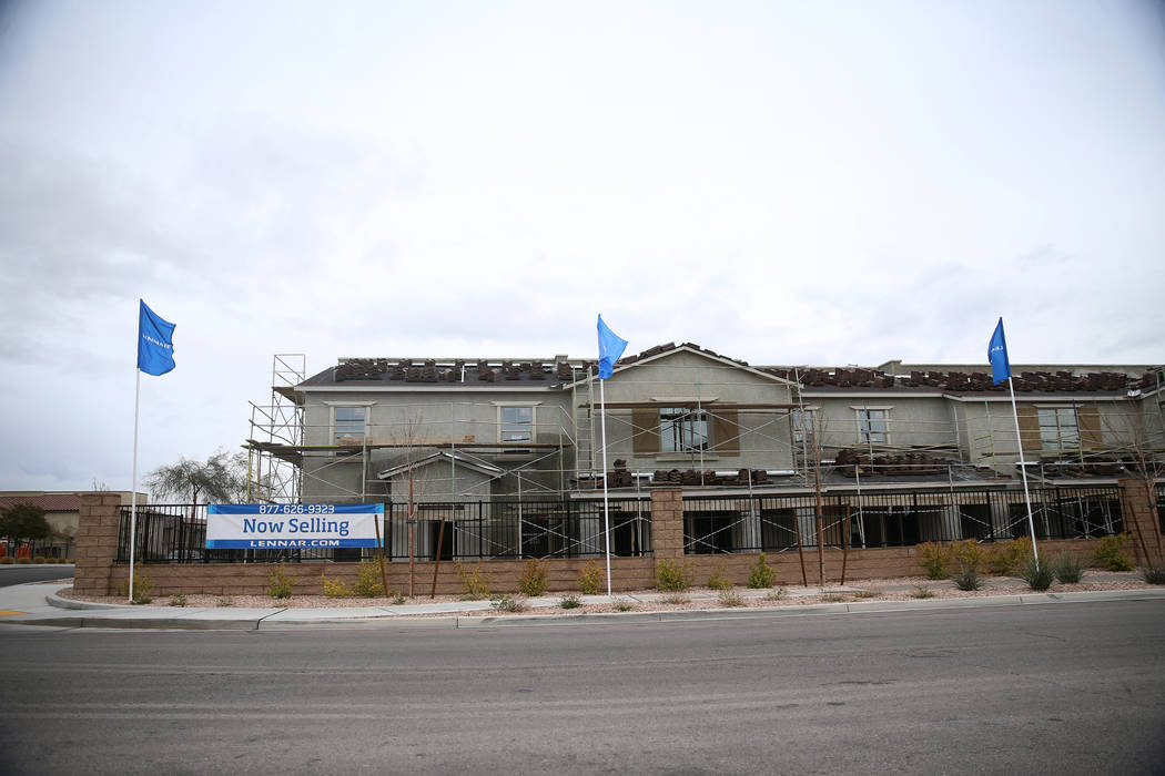 Homes under construction in the Lennar Madori Vista residential community in Las Vegas, Friday, ...