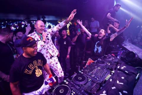 Tyson Fury and DJ superstar Steve Aoki are shown celebrating his seventh-round TKO victory over ...
