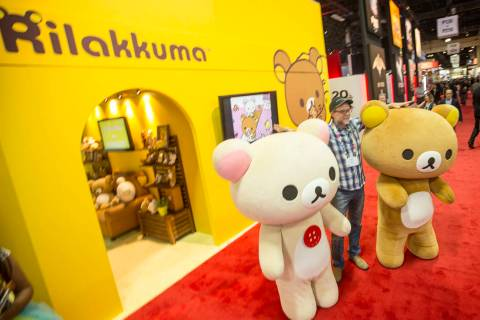 Greg Nuson poises for a photo with Rilakkuma cartoon characters during the Licensing Expo 201 ...