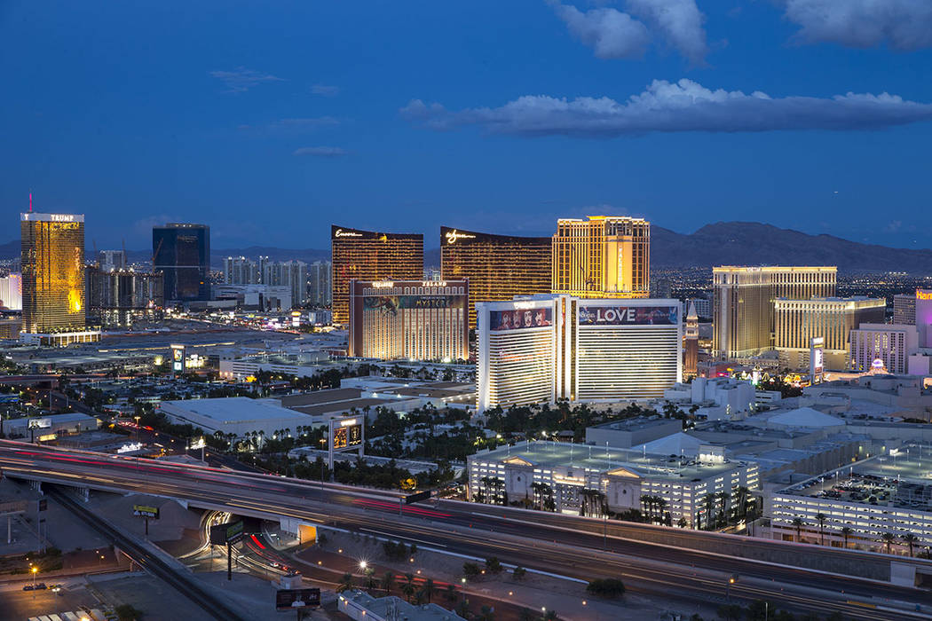 The Strip lights up at dusk as seen from the VooDoo Lounge atop the Rio hotel-casino in Las Veg ...
