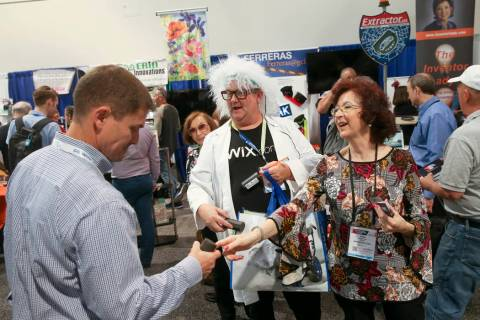 Rita Crompton, of Denver, founder of The Inventor Lady, and Jimi Bush give free samples of the ...