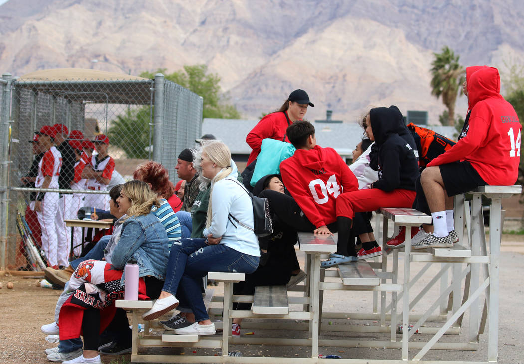Parents and students watch a baseball game between Pahranagat Valley High School and Lincoln Co ...
